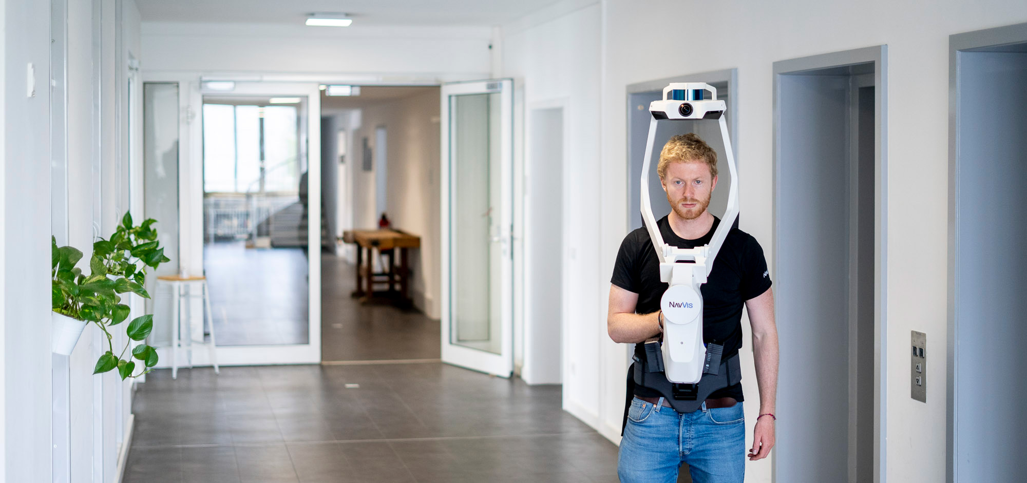 The NavVis VLX wearable indoor mobile mapping system equipped with two Velodyne Lidar Puck LITE lidar sensors